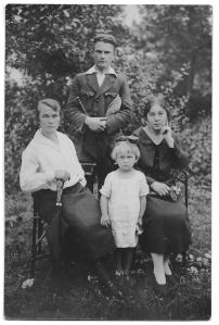 My mother, as a little girl with her mother in the white blouse and her beloved uncle Franek, as a very young man.